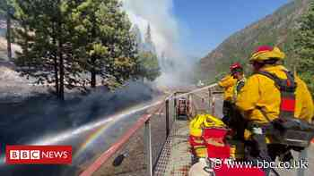 Wildfires: Firefighters battle blaze from top of moving train