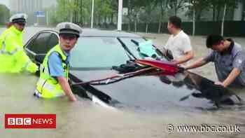 Zhengzhou Henan: Waist-high flooding hits China trains and roads