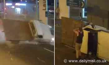 A ute has run a red light before being flipped in Launceston, as drivers response enrages viewers - Daily Mail
