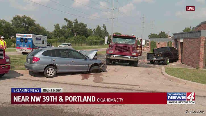 Pickup slams into building following vehicle crash in Oklahoma City