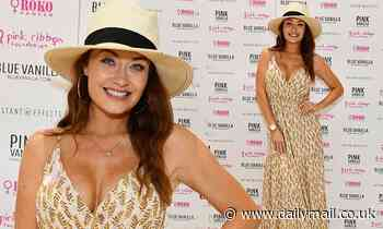 Jess Impiazzi puts on a stylish display in flowing floral maxi dress and straw hat