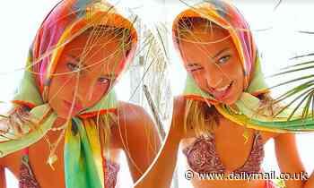 Mia Regan flaunts her model figure in a funky string bikini and silk rainbow scarf