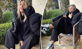 Phoebe Burgess shows off her rare sneakers as she poses for a winter photoshoot