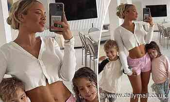 Tammy Hembrow shows off her incredible abs while posing with her children