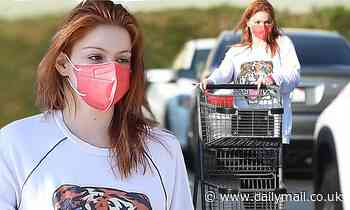 Ariel Winter dons a red mask to match her newly dyed hair as she leaves a beauty salon in LA