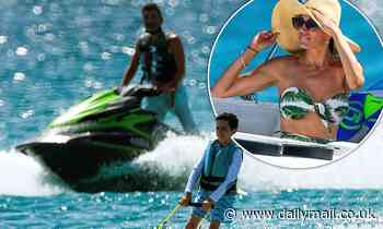Lauren Silverman watches Simon Cowell and son Eric, 7, enjoy water sports in Barbados