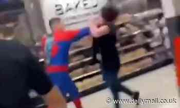 Shocking moment thug in Spider-Man outfit PUNCHES female Asda worker in FACE