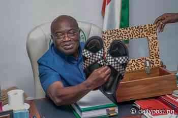 PHOTO NEWS: Ikpeazu displays first pair of sandals he made in Aba-based Footwear Academy - Daily Post Nigeria