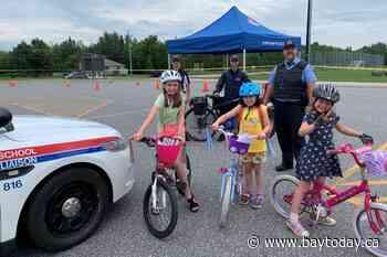 Bike rodeo delights kids, gives students a taste of policing - BayToday.ca