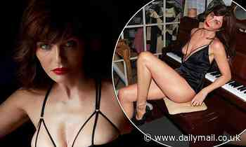 Helena Christensen, 52, sizzles in black satin lingerie as she lounges on a piano