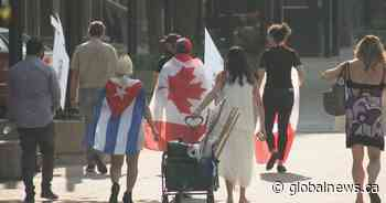 Cubans living in Calgary gather to protest government crackdown in their homeland