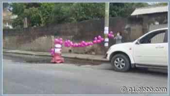 Moradora de Santa Isabel organiza 'festa de aniversário' para buraco em protesto contra falta de manutenção - G1