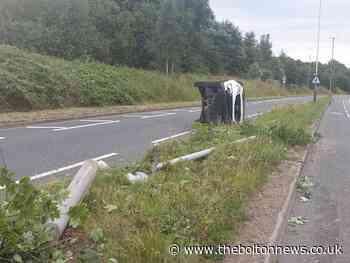 Uninsured driver flips car on side in Bolton avoiding fox