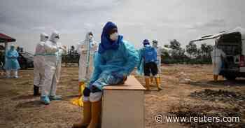 Malaysia reports record 15902 new coronavirus cases - Reuters
