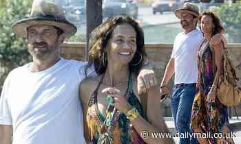Gerard Butler and his on-again girlfriend Morgan Brown take a stroll in Malibu