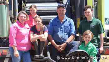 Sam Simpson and Mark Billing use pink silage wrap at Colac - The Australian Dairyfarmer