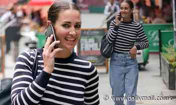 Kirsty Gallacher cuts a casual figure in jumper and mom jeans as she steps out of Smooth Radio