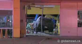 Man arrested after pickup truck crashes into Montreal business: police