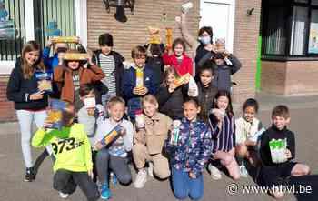 Voedselinzamelactie door vierde leerjaar van De Zandkorrel in Hechtel - Het Belang van Limburg