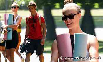 Nina Agdal cuts a trim figure as she heads to a yoga class with her boyfriend Jack Brinkley-Cook