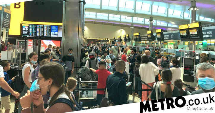 Minister sorry for 'chaos' at airports as thousands queue to leave UK