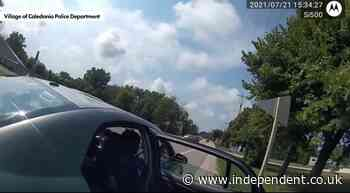 Police respond to viral video showing officer appearing to toss a baggie into man's car