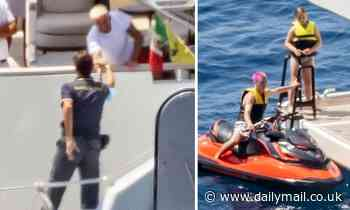 PICTURED: David Beckham fist-bumps an Italian officer after being 'quizzed' about jet skis