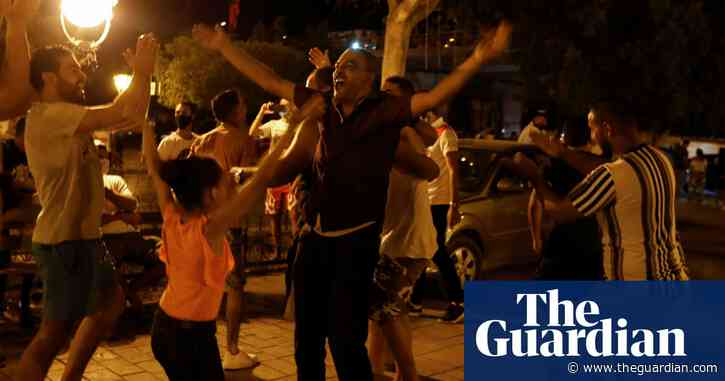 Tunisia president sacks government, sparking jubilation on streets