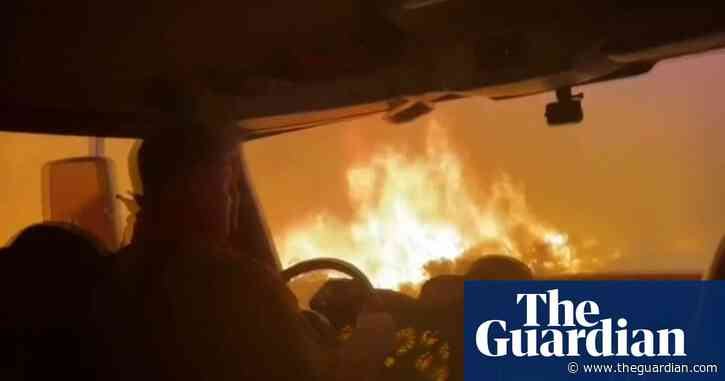 Firefighters escape Tamarack wildfire by driving through flames –video