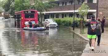 Passengers rescued from bus by volunteers in rubber dinghy during flash floods