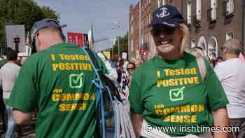 Large crowds protest vaccine passports in Dublin - The Irish Times