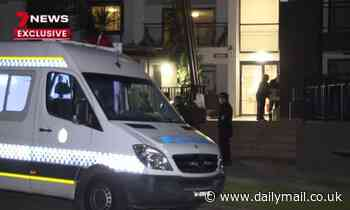 Apartment block in isolation and under police guard as 100 are tested for Covid in Sydney's west