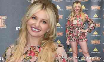 Amy Hart shows off her style credentials in a pink floral playsuit at Wonderville opening night