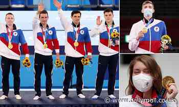 Ban? What ban? Russian athletes leap into third spot in the Olympic medal table despite doping ban