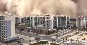 Apocalyptic 300ft sandstorm swallows city as buildings vanish in orange cloud