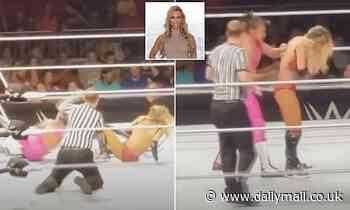 WWE star Carmella's bra bursts open mid match but she keeps fighting and doesn't flash a single fan