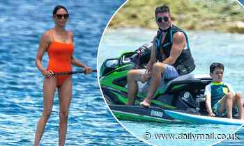 Simon Cowell's girlfriend Lauren Silverman wows in orange swimsuit on Barbados vacation with family