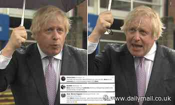 Boris Johnson leaves viewers bemused as he gets soaked despite brolly