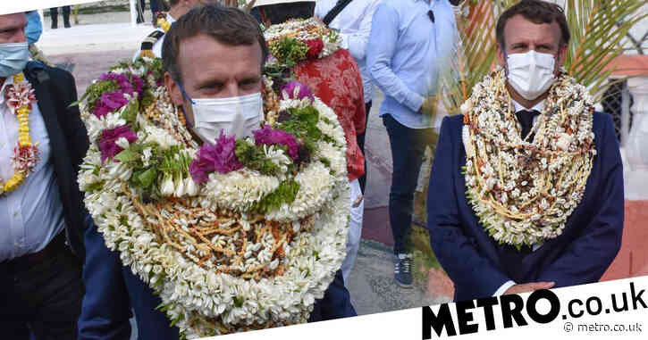 Macron turns into human wreath after arriving at remote Pacific island