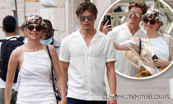 Pixie Lott and Oliver Cheshire visit the Vatican in Rome... where the singer is forced to cover up