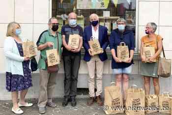 11.11.11 schenkt consumptiecheques aan asielzoekers (Lennik) - Het Nieuwsblad