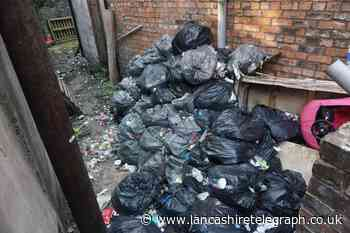 'It's disgusting and attracts rats': No-one wants to take responsibility for pile of rubbish dumped in back alley