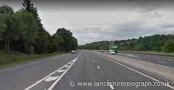 Black BMW crashes closing entry slip road of M65