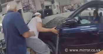 Heroes lift car off baby trapped under car after it crashes into barber shop
