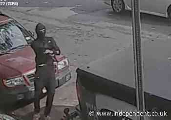 Masked gunman caught on camera opening fire on busy New York City street