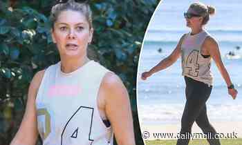 Natalie Bassingthwaighte enjoys a stroll in Byron Bay - after escaping covid-ravaged Melbourne