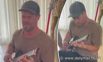 Chris Hemsworth shows off awful singing skills as he plays Home and Away theme song on guitar
