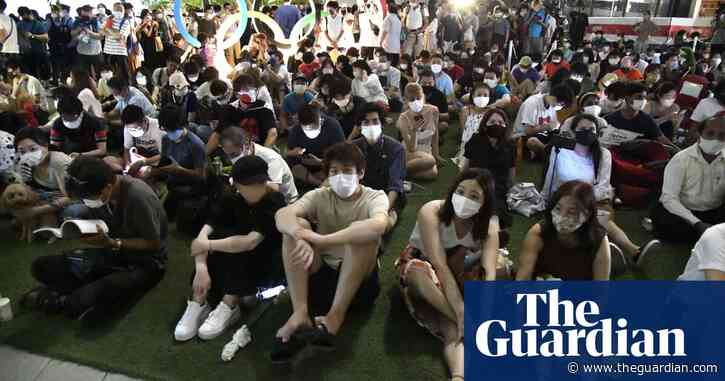Japan urges young people to get jabs and stay in amid Tokyo Covid surge