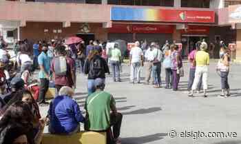Bancos de Cagua full de personas retirando efectivo - Diario El Siglo