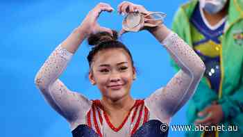 Sunisa Lee wins gymnastics gold for US as Simone Biles watches on